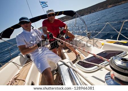 "SARONIC GULF, GREECE - SEPTEMBER 25: Unidentified sailors participate in sailing regatta ""Viva Greece 2012"" on September 25, 2012 on Saronic Gulf, Greece. - stock photo"
