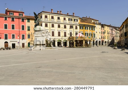 SARZANA, ITALY - APRIL 13: cityscape with old houses on central square on a sunny  morning in mediterranean inland little town, shot  on april 13 2015  Sarzana, Italy  - stock photo
