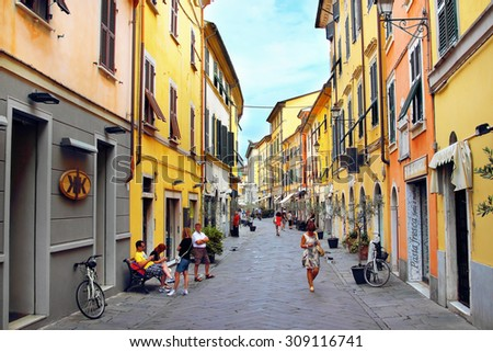 SARZANA, ITALY - AUGUST 10, 2015: Streets in Sarzana, Italy. Historic colored buildings.