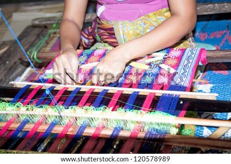 Sasak tribe lady weaving, Sade, Lombok, Indonesia - stock photo