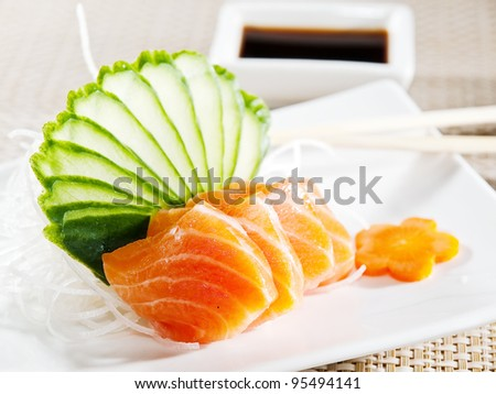 Sashimi. Garnished with Ginger, Wasabi, Cucumber, Salad Leaf and Lemon - stock photo