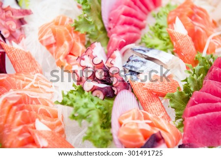 Sashimi on iced glass dish, japanese food, Fresh catch of fish and other seafood close-up - stock photo