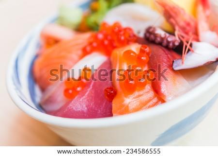 sashimi raw fish seafood rice bowl - japanese food - stock photo