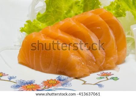 Sashimi salmon sliced on a plate. - stock photo