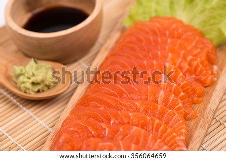 Sashimi salmon sliced  with wasabi on wooden plate - stock photo