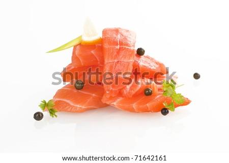 Sashimi sushi. Raw salmon pieces arranged on white background. - stock photo