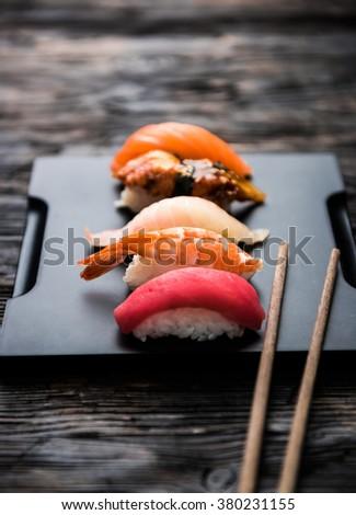 sashimi sushi set with chopsticks and soy - stock photo