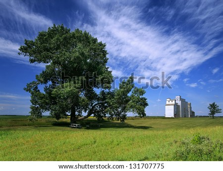 Saskatchewan - Countryside with grain elevator and meadows, Canada - stock photo