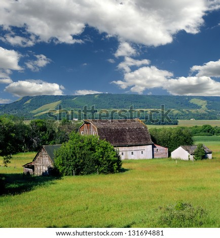 Saskatchewan - Qu' Appelle Valley, countryside with ranch, fields, barn and meadows, Canada - stock photo