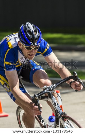 SASKATOON, CANADA - MAY 21: unidentified Cyclists compete for the annual Bikes on Broadway race on May 21, 2012 in Saskatoon, Canada