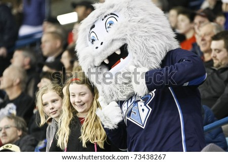 SASKATOON - MARCH 17: Fans and the mascot for the Saskatoon Blades Hockey Team in a game between the Moose Jaw Warriors and the Saskatoon Blades on March 17, 2011 in Saskatoon, Canada.