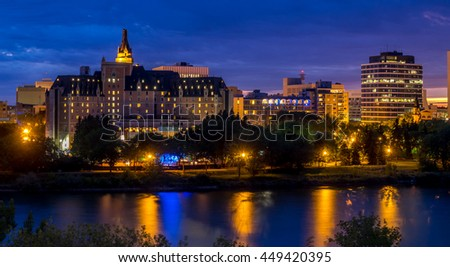 Saskatoon skyline at night along the Saskatchewan River.