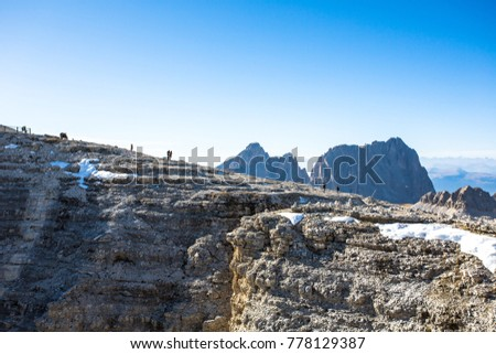 https://thumb7.shutterstock.com/display_pic_with_logo/3261806/778129387/stock-photo-sass-pordoi-is-a-plateau-shaped-massif-mountain-of-sella-group-in-the-dolomites-from-top-of-the-778129387.jpg