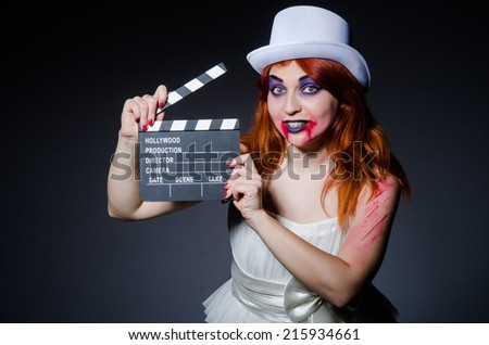 Satan halloween concept with movie clapper board - stock photo