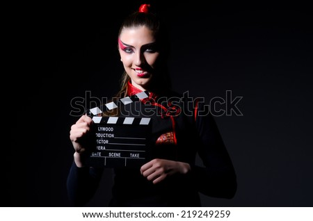 Satan halloween concept with movie clapper board - stock photo