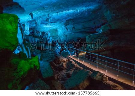 Sataplia cave in Georgia lit by different colors - stock photo