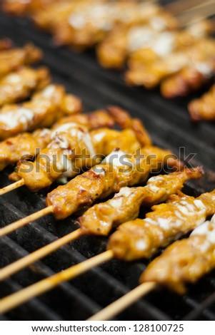 Satay chicken on grill. - stock photo