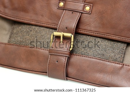 Satchel bag with gold buckle - stock photo