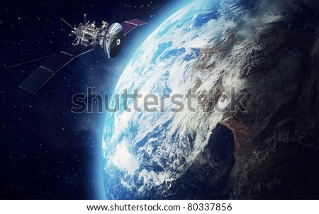 satellite and earth - stock photo