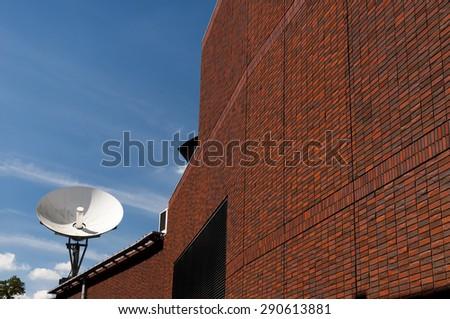 Satellite antena on the building - stock photo