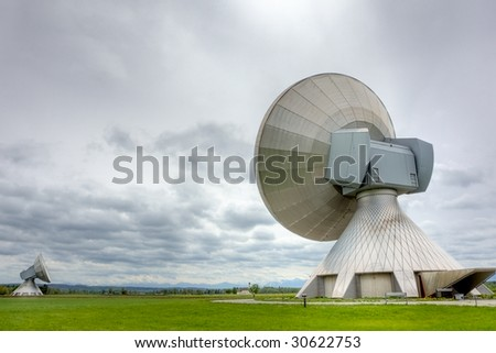 Satellite communiations installations - the type used for broadcasting. Poor weather. - stock photo