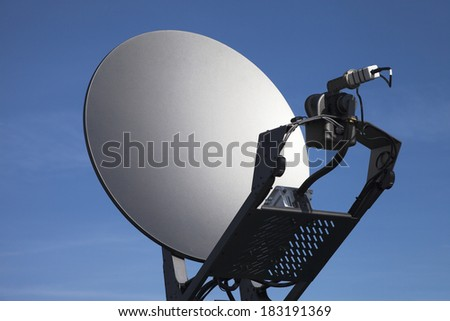 Satellite dish against blue sky. - stock photo
