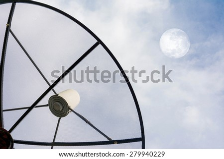 Satellite dish against cloudy sky with moon on sky . . Elements of this image furnished by NASA
