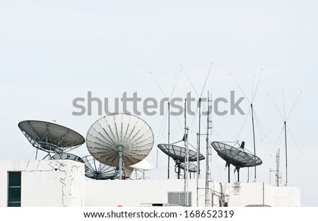 satellite dish and antenna on building - stock photo