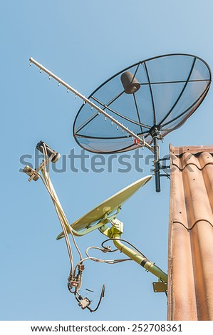 Satellite Dish and Antenna TV on the house roof - stock photo