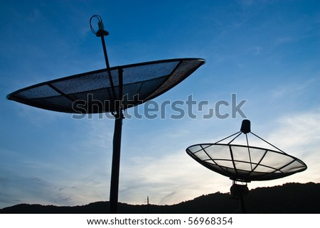Satellite dish and blue sky - stock photo