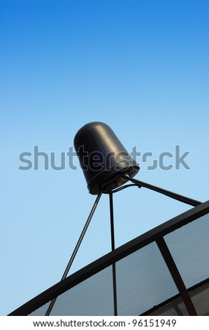 Satellite dish and blue sky - stock photo