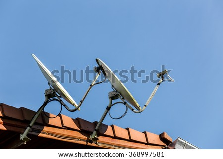 Satellite dish antenna on top of the building - stock photo