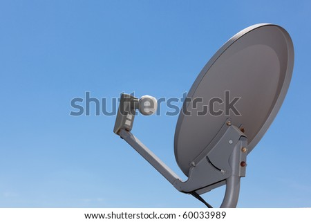 Satellite Dish Antenna with blue gradient sky. Copy space - stock photo