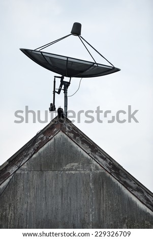 satellite dish antennas on roof - stock photo