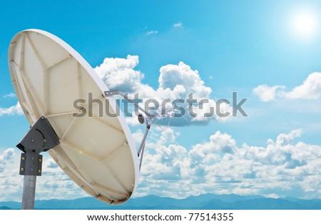 satellite dish antennas under blue sky - stock photo