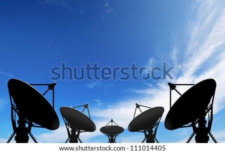 satellite dish antennas under blue sky with white cloud - stock photo