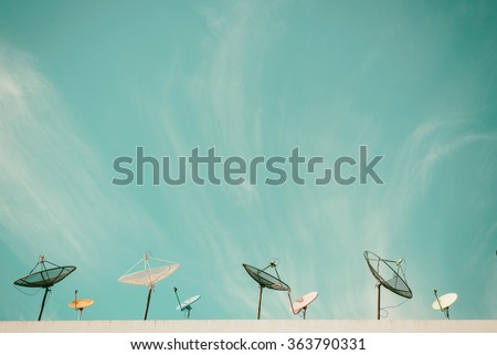 satellite dish antennas under skyVintage pastel - stock photo