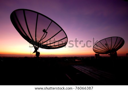 Satellite dish at sunset - stock photo