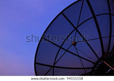 Satellite dish closeup with evening sky background - stock photo