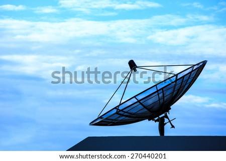 Satellite dish in blue sky - stock photo