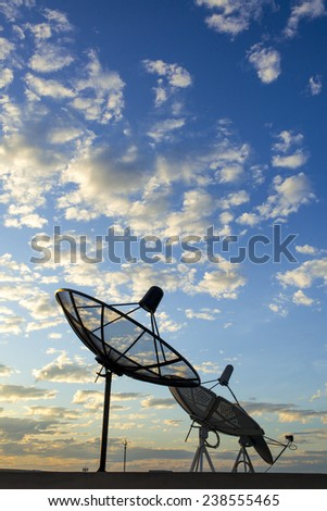 satellite dish in cloud sky - stock photo