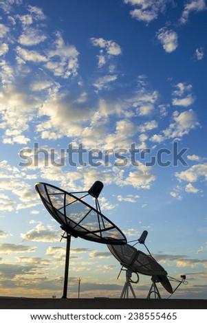 satellite dish in cloud sky - stock photo