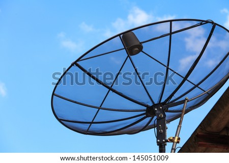 Satellite dish in morning sky