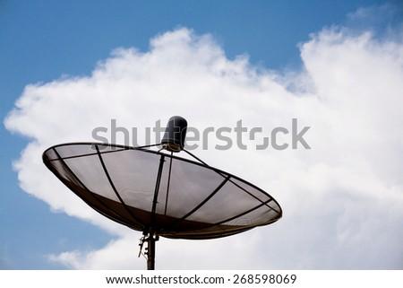 Satellite dish in morning sky - stock photo