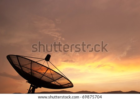 Satellite dish in morning sky - stock photo