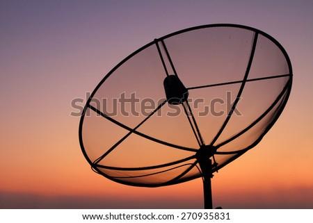 satellite dish in sunset time - stock photo