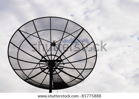 Satellite dish in the cloudy sky - stock photo