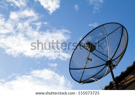 Satellite Dish Install on the Roof. - stock photo