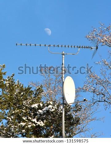 Satellite dish on a sky background - stock photo