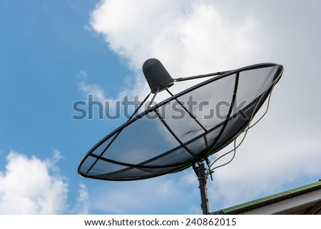 Satellite dish on background blue sky